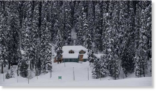A view of a snow covered hut in Gulmarg, 55 kilometers north of Srinagar,