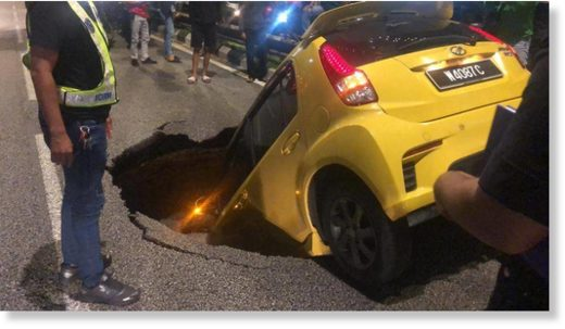A Myvi was swallowed by a sinkhole in the heart of Kuala Lumpur on Nov 25
